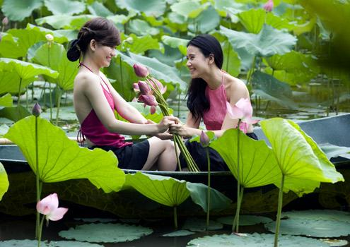 Vietnamese girls charming with lotus flowers mightylinksfo